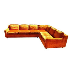 """Used Mid-Century Orange Crushed Velvet Sectional Sofa - Make a statement with this Orange Crushed Velvet Sectional Sofa!  Couch is low to the ground with a low back and a deep seat area perfect for lounging.  There are two pieces (one smaller and one larger), each with castors and regular feet to make it a little easier to move.  This piece is original and would be a great re-upholstery project.  Heavy great bones with that classic modern style.  Sofa has some worn edges and has lived a great life.    Large Piece is 24"""" Tall, 34"""" Deep, and 113"""" Wide  Small Piece is 24"""" Tall, 34"""" Deep, and 51"""" Wide"""