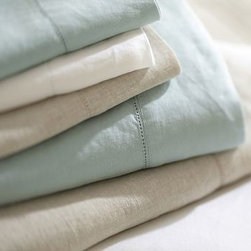 Linen Solid Sheet Set, Cal. King, Porcelain Blue - Lustrous, smooth and cool to the touch, our linen sheets are an everyday luxury. Made of pure linen. Pre-washed and pre-shrunk. Set includes flat sheet, fitted sheet and two pillowcases (one with twin). Pillow insert sold separately. Machine wash. Imported.