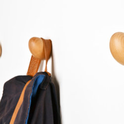 """Coat Eggs, Wooden Eggs Coat Hanger - Fresh from the henhouse, Coat Eggs are a natural product of the idea farms at Daniel Schofield Design. Each of the eggs is carefully crafted with a rounded surface that makes snagged sweaters and deformed coat collars a thing of the past. The humorous concept and fun look of the eggs will entertain and turn any frown sunny-side up. More durable in comparison to their common cousin, Coat Eggs are made from solid Beech and come with a screw on the backside for easy attachment to entrance halls or bedroom walls. Carefully packaged in cartons of half a dozen and shipped with a label that reads """"Laid in Yorkshire,"""" the eggs are guaranteed to arrive safely and hatch into a flock of fun."""