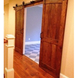 """Barn Doors - This is a stunning design we did for one of our customers...they sent us a photo of their space and we just went from there.  The Dual Radius design gives the illusion of a rounded doorway...Brilliant idea! This sliding barn door is made of hand-selected reclaimed Oak circa 1800s. The antique wood is character rich and retains its original nail holes, knot holes, checks and voids. Handcrafted in the stile and rail tradition (Stiles/Rails are a beefy 1.5"""" thick!), this door uses rabbit joint construction with inset vertical panels which are lightly sanded, sealed and finished with a """"smooth to the touch"""" oil based finish."""