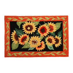Homefires - Sunflowers On Black Rug - Flower power. These striking sunflowers can brighten your room instantly, with a brilliance and warmth heretofore reserved for solar energy. This rug is completely machine washable, too, so a little soap and water only makes them bloom brighter.