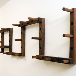 Thru Block Coat Rack - This very simple hanging system really looks more like an installation at a contemporary museum of art to me. Designed by Will Ullman