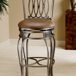 Hillsdale - Faux Leather Upholstered Wrought Iron Swivel - This attractive stool comes in Bar or Counter seat heights and features an Old Steel frame finish with Brown Faux Leather seats. The elaborate design combined with the elevation of the chair makes for a heavenly sitting experience. Ornamental and elegant, these are stools that will provide an inspiration in any space. Every detail is beautifully defined including the decorative stretchers and swivel base. Handsomely cast with double arched steel rod legs, a comfortably padded seat upholstered in faux leather, its smooth swivel mechanism allows for full rotation. * For residential use. Heavy duty forged steel. Antiqued Old Steel finish. Faux leather upholstery. 360 Swivel mechanism. Cherry finish topped backrestDimensions:. 43H x 20W x 18D (28 in - Seat Height)Drama and style are defined in Hillsdale Furniture's Montello Bar Stool ensemble. Sweeping interlocking circles, intricate complimentary castings and elegantly curved legs combine to create a collection with grace, movement and elegance. Available in both counter and bar heights and with 360 degree swivel. Finished in a dynamic old steel with distressed brown faux leather seats and wood accents.