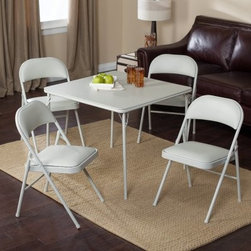 Meco Sudden Comfort Deluxe Double Padded Chair and Back- 5 Piece Card Table Set - Give your next gathering a shot at success by using the Sudden Comfort 5-Piece Card Table Set - Grey Dream for extra dining space. The comfortable padded chairs and soothing gray tones will keep guests comfortable and blend effortlessly with any surroundings. The classic square card table has a sturdy steel frame supporting a hardboard top. The legs fold flat for storage and have E-Z action slide leg locks for quick set up or tear down. Both the extra-wide seats and contoured backs of the four included chairs are padded with 1.5-inch-thick high density foam. The quality Y-frame design and triple-welded leg braces ensure the utmost in support and stability. The table top and the padded chair seats are covered in vinyl which quickly wipes clean in the likely event of food and drink spills. Non-marring leg caps prevent the table and chairs from scuffing your floors or snagging on the carpet.