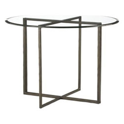 "Everitt 42"" Round Glass Top Dining Table - Open seating in modern mixed media with artisanal detailing. A simple crossbar frame of hand-hammered steel supports a thick round of clear glass with polished edge. Two-piece ""T-bar"" base is brass-plated, then antiqued to a dark finish."