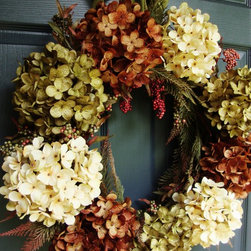 Fall Hydrangea Berry Wreath by HomeHearthGarden - An elegant combination of colors, this wreath design captures a the elements of fall with artificial green hydrangeas, brown hydrangeas, and white hydrangeas on a natural grapevine wreath base. A collection of faux berries and artificial spruce branches are intermixed with the hydrangeas to provide a unique fall door decoration.