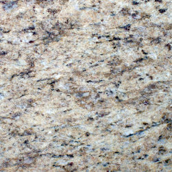 Giallo Ornamental Granite - Giallo Ornamental granite. Brown, white and black with small cranberry flakes