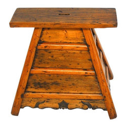 """Pre-owned Chinese Wooden Barber's Stool - Rare, antique Chinese wooden barber's stool. This was the equivalent to a barber's chair in China circa 1800's. The barber's customer would sit on the stool for a hair cut and shave and to have his pig tail oiled. When finished he would put the money in the slot on top of the seat.    The stool has two side drawers with brass pulls to hold tools and a large, flat seat. Pyramid style construction with relief carved apron of a pagoda on all four sides. Great conversation piece and in excellent condition with old world joinery. Strong & stable with an mazing aged patina.    Dimensions: 18""""w x 13""""d x 16""""h"""