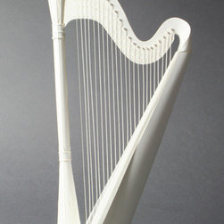 Harp Paper Craft Kit - Most people don't get to claim bragging rights over the gorgeous little things in their homes, but with some patience and skill you can become a paper sculptor thanks to this kit for music lovers. A precise reproduction of the real thing, this paper harp cuts an elegant silhouette and would make a playful accompaniment for a white bookshelf filled with music and art books.
