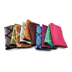 Tile Napkins - A graceful large-scale arabesque pattern is printed in a glamorous high-contrast hue over the linen weave of the luxurious Tile Napkins. The rich colors and curvaceous shapes are perfectly Moroccan but simply executed, made to  blend with either old-world imported accents or globally-sourced transitional themes. Sold as a set of four, these cloth napkins are available in multiple striking color combinations to bring your table alive.