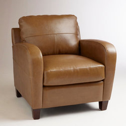 World Market - Latte Leather Mason Chair - With an extra-deep seat and plush backrest angled for comfort, our Latte Leather Mason Chair is built for those sit-back-and-stay-awhile moments. Premium quality bi-cast leather upholstery in soft latte covers a solid wood frame constructed for durability and daily use. Its high rounded armrests recall retro design, creating a fashionable yet functional seating choice for any environment.