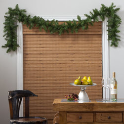 None - 9-feet Aspen Garland - Update your home with a festive spirit with this nine-foot aspen garland. This unlit garland has medium-length needles with pointed tips and a medium shade of green.