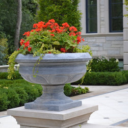 Solid Stone Planters and Urns - Solid Stone planters and urns for the garden, patio, pool, or entryway.  Available in Marble, Limestone, Granite, and Travertine.  These are NOT concrete, pre-cast or resin.  Appropriate for any climate. View website for specially priced planters and urns.