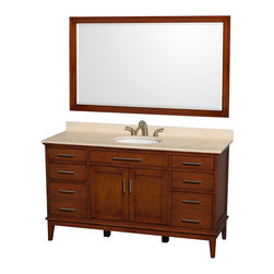 Wyndham Collection - 60 in. Eco-Friendly Bathroom Vanity in Light Chestnut - Includes matching mirror, ivory marble countertop with backsplash and undermount oval porcelain sink. Faucet not included. Engineered to prevent warping and last a lifetime. 12-stage wood preparation, sanding, painting and hand-finishing process. Highly water-resistant low V.O.C. sealed finish. Transitional styling. Practical floor-standing design. Deep doweled drawers. Fully-extending under-mount soft-close drawer slides. 8 in. widespread 3-hole faucet mount. Concealed soft-close door hinges. 1.25 in. mirror thickness. Plenty of storage and counter space. Single faucet hole mount. Metal exterior hardware with brushed chrome finish. Made from solid birch hardwood. Backsplash: 60 in. W x 0.75 in. D x 3 in. H. Vanity with countertop: 60 in. W x 22 in. D x 35 in. H. Countertop: 60 in. W x 22 in. D x 0.75 in. H. Mirror: 56 in. W x 33 in. H (52 lbs.). Vanity: 60 in. W x 22 in. D x 35 in. H (185 lbs.). Warranty. Care Instructions. Vanity Installation Instructions. Mirror Installation Instructions. Counter Handling InstructionsBring a feeling of texture and depth to your bath with the gorgeous Hatton vanity series. A contemporary classic for the most discerning of customers. The Wyndham Collection is an entirely unique and innovative bath line. Sure to inspire imitators, the original Wyndham Collection sets new standards for design and construction. Compliments any bathroom.