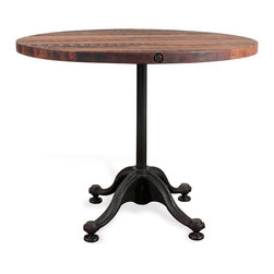 Kathy Kuo Home - Pedro Reclaimed Wood Industrial Round Bistro Cafe Dining Table - Been searching for the perfect table for your breakfast nook? Consider the search complete. This stunning reclaimed industrial table features cast iron curved legs and a natural hardwood top. Bring a bit of Parisian bistro to your kitchen, with an antique piece that feels like it should come complete with check board floors and pomme frites. A chic statement that'll have you clamoring for pancakes multiple times a day, this table is vintage industrial style at its best. Enjoy a one year warranty on this piece.