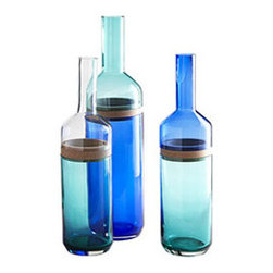SPLIT-TOP BOTTLE VASES - SET OF 3 - It's funny how innocuously collections start. Like with a set of three glass and wood bottles, ultra modern and amazingly unique. The blue and clear parts are glass, while a thin band of wood separates the top and bottom so you can make your own combination of color pairings. We wouldn't presume to tell you what to do with your own budding collection, but we do love these set out casually on a console: The blue really makes these pop.