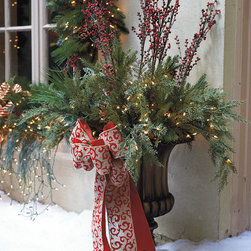 """Frontgate - 44"""" Pre-lit Estate Urn Filler Christmas Decor - Full, thick greenery appears fresh-cut. Decorated with crimson berries and pinecones. Super-bright, 3,000-hour lights. 6-ft. cord, 120-volt cord. Indoor or outdoor use. Create a dramatic and spectacular holiday presentation with our incredibly lush Estate Urn Filler. This urn filler is brimming with an abundance of sweeping pine needles, sugar pinecones, and weather-tested berries, carefully intertwined with long-lasting, clear bright lights.  .  .  .  .  . To maximize fullness, greenery will need to be shaped. Urn sold separately."""
