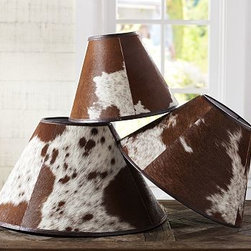 "PB Basic Cowhide Lamp Shade, Large - Wrapped with panels of natural cowhide, these leather-trimmed shades give lighting a rustic look. Since the hide's natural markings vary, no two shades are alike. Small: 13"" diameter, 10"" high Medium: 17"" diameter, 11.25"" high Large: 21.25"" diameter, 11.5"" high Shade is crafted with brown and white cowhide, patterns will vary; lined with styrene. Pair with any of our Mix & Match(R) lamp bases (sold separately)."