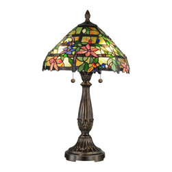 Dale Tiffany - Dale Tiffany TT12364 Trellis Traditional Tiffany Table Lamp - The innovative design and painstaking attention to detail you have come to expect from Dale Tiffany once again shines through in the Trellis table lamp. The gently domed shade features a floral vine with pastel pink, lavender and blue blossoms winding its way through a brown trellis. Set against a background of lush green leaves and sunny yellow art glass, our artisans have added art glass jewels in red, blue, yellow, white and green for depth and texture. The shade's bottom edge is cut out along the borders of the leaves and petals for realistic detail. The metal base is reeded and features a fleur de lis pattern both on the column and just under the shade. The base and matching finial are both finished in fieldstone for an added natural feel. A perfect accompaniment to any décor style, the Trellis lamp is a wonderful way to bring a taste of the great outdoors into your home or office.