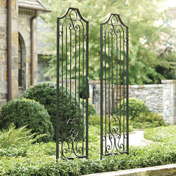 Ballard Designs - Garden Gate Screen - Distressed black finish. Gold undertones. One of the prettiest ways we've found to secure climbing plants in the garden or porch while adding a sophisticated architectural touch. The sturdy iron frame hangs or stands on two sets of included 4-point claw feet that dig deep into the soil for a stable hold. Garden Gate Screen features: . .