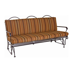 O.W. Lee - O.W. Lee Heartland Sofa Glider - 767-3G-SP08-GL49B - Shop for Chairs and Sofas from Hayneedle.com! With an O.W. Lee Heartland Sofa Glider in your backyard living area you'll be glad glad glad to have your friends arrive. And its comfortable frame and cushions will make you all glad glad glad to be alive. Its structure balances simplicity with design always keeping an eye on functional comfort. Without added detail to clutter the strong line quality and the elegance of each part you can clearly see the tremendous craftsmanship that goes into this sofa as a whole. The slightly angled back welcoming arms and glider base create a durable form that allows you rest easy while knowing that this piece will last for years. The seat and back cushions only heighten this experience made from superior foam and fiber filling and covered in high-quality Sunbrella fabric. And being able to choose your own frame and fabric color allows you to find a combination that will fit your personal decorating tastes perfectly. Meanwhile the classic wrought iron fashioning of these pieces is timeless and universal enough to fit in any exterior decor scheme. So to paraphrase the well-known Phish anthem you'll simply be glad glad glad glad glad to glide.Materials and construction: Only the highest quality materials are used in the production of O.W. Lee Company's furniture. Carbon steel galvanized steel and 6061 alloy aluminum is meticulously chosen for superior strength as well as rust and corrosion resistance. All materials are individually measured and precision cut to ensure a smooth and accurate fit. Steel and aluminum pieces are bent into perfect shapes then hand-forged with a hammer and anvil a process unchanged since blacksmiths in the middle ages. For the optimum strength of each piece a full-circumference weld is applied wherever metal components intersect. This type of weld works to eliminate the possibility of moisture making its way into tube interiors or in a crevasse. T