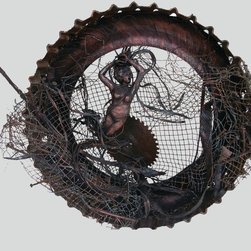 """Entangled: Goddess Series - 29""""w x 21""""h x 13""""d  Found object abstract sculpture of woman. Tire tread, saw blade, wire, terracotta clay,nails, paint & stain"""