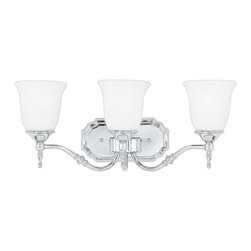 Quoizel - Quoizel TT8603C Tritan 3 Light Bathroom Vanity Lights in Polished Chrome - Long Description: This timeless fixture features lovely bell-shaped shades that provide a bright, yet soft light, and the classic finish coordinates with many faucets styles.