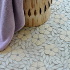 Jacqueline Stone Mosaic - Jacqueline, a natural stone waterjet mosaic, is shown in tumbled Bianco Antico, Blue Macauba, and Carrara.