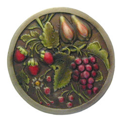 "Inviting Home - Tuscan Bounty (hand-tinted antique brass) - Hand-cast Tuscan Bounty Knob in hand-tinted antique brass finish; 1-9/16"" diameter; Product Specification: Made in the USA. Fine-art foundry hand-pours and hand finished hardware knobs and pulls using Old World methods. Lifetime guaranteed against flaws in craftsmanship. Exceptional clarity of details and depth of relief. All knobs and pulls are hand cast from solid fine pewter or solid bronze. The term antique refers to special methods of treating metal so there is contrast between relief and recessed areas. Knobs and Pulls are lacquered to protect the finish. Alternate finishes are available."