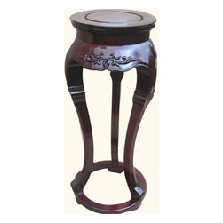 "n/a - 14"" Dia Solid Rosewood Three Legged Asian Plant Stand - Elegant solid rosewood Asian Plant Stand. Sleek and stylish, this 3-legged piece is 100% hand carved and lacquered to a satin finish. Your living room will truly sparkle. Meticulous Chinese craftsmanship is evident in every detail. Sturdy tongue and groove construction. Joined without nails. Surround this stately table with another choice from our vast collection of solid rosewood Oriental pieces. This incredible value is in limited supply. Get yours now. 14��Dia. at widest, 11"" Dia top x32��H"