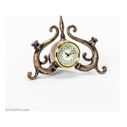 Cyrano Clock - This unique time piece has lots of personality. Made of brass and metal.