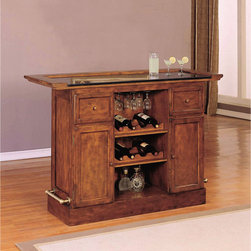 Brandon Warm Cherry Bar by Powell - Old English panel and frame design with removable full overhang framed granite top and antique brass finished foot rails. Storage features and functions includes 2 drawers for barware and utensils, 2 doors with shelves behind, 3 stemware racks for up to 12 wine glasses depending on size).
