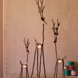 Rustic Iron Reindeer Tea Light Holder (Set of 3) - Tall, skinny and slightly twisted, our set of three rustic reindeers carry the load of a tea light on their backs, but their comical faces are serene and sociable. The set of three comes with one of each size: Small, Medium, and Large.