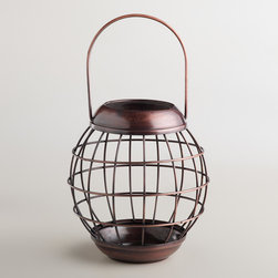 Round Metal Wire Lantern - Candlelight makes every evening more memorable, doesn't it? I would place a couple of these on the coffee table, or even hang them from a line of nails on the wall.