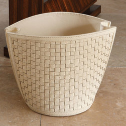 Woven Wastebasket - Mink - A well-styled addition to the transitional office or bath, the Woven Wastebasket fits neatly into narrow spaces with its room-saving form inspired by chic shopping bags, while a woven wall pattern adds texture to the floor or counter. The folds of the narrower walls suggest a stylish approach to the practicalities of utilitarian rooms, a look that's easy to coordinate.