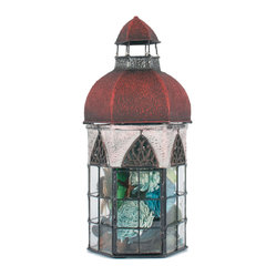 The Firefly Garden - Under Heaven's Skies - Under Heaven's Skies is our collection of decorative, miniature conservatory lanterns. Filled with fairy lights that gleam through colored glass in pink, blue, red or green, you'll find your gaze drawn into a small, secret diorama of lush flowers, palm belly and treasures.