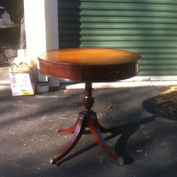 Vintage Round Leather Top End Table - Vintage Leathertop end table. 1940s. Mahogany. Brass feet and casters. Some wear to the leather and on legs but for the price, it is very nice.