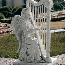 Eclectic Garden Statues And Yard Art by Design Toscano