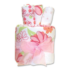 """Trend Lab - Gift Cake - Hula Baby Hooded Towel - Trend Lab's Gift Cake is the perfect shower centerpiece and a practical gift for any mom to be. Gift set contains one hooded towel and three wash cloths. Hooded towel is white terry with an exotic floral print combining pink and green with pops of yellow and orange on the hood and trim. Wash cloths each have fun, modern printed cotton on the front with terry on the back. Wash cloth patterns include: floral print combining pink and green with pops of yellow and orange, mini floral print in pink and green and white with pink dots. Hooded towel measures 32"""" x 30"""" and wash cloths 8"""" x 8"""". Hooded towel is wrapped around all three wash cloths to resemble a cake with topper and packaged in clear cellophane with ribbon and gift tag."""