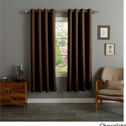 None - Grommet Top Thermal Insulated 72-inch Blackout Curtain Panel Pair - Improve your home by installing this well-insulated curtain panel pair. Made from polyester,these window accessories include tiebacks to help you customize the look. They block sound and light,making them smart picks if you're a daytime sleeper.