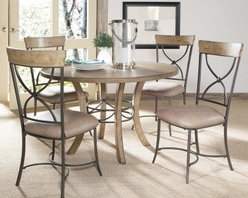 Hillsdale Charleston 5 piece Round Desert Tan Wood Dining Set with X-Back Chairs - Blending traditional and modern designs the Hillsdale Charleston 5 pc. Round Desert Tan Wood Dining Set with X-Back Chairs makes a great addition to any dining room. Built from wood and metal this dining set is finished in sandy brown with dark gray metal. The table features a metal sculpture accent in the base while the chairs have sandy brown faux leather upholstery and wood accents to match the table's top. About Hillsdale FurnitureLocated in Louisville Ky. Hillsdale Furniture is a leader in top-quality affordable bedroom furniture. Since 1994 Hillsdale has combined the talents of nationally recognized designers and globally accredited factories to bring you furniture styling and design from around the globe. Hillsdale combines the best in finishes materials and designs to bring both beauty and value with every piece. The combination of top-quality metal wood stone and leather has given Hillsdale the reputation for leading-edge styling and concepts.