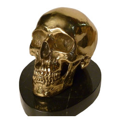 Bronze Skull - This beautiful hand-cast bronze skull sits atop a marble base and is a perfect gift.  It is very stylish and decorative and fits that unique situation where you may need a skull to set the tone.  The skull is very detailed and is just short of being an adult life size skull.  The weight is approximately 12 lbs.