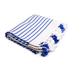 Moroccan Tassel Bath Mat - Bright blue and white is one of my favorite color combinations, and I would use this textured mat in a bathroom or in front of the kitchen sink.
