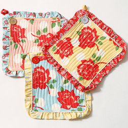 Swell Pot Holder Set - I love the vintage feel of these potholders. I have some similar ones dangling from my cabinet knobs next to the oven. Textiles are a great way to add warmth to the kitchen.