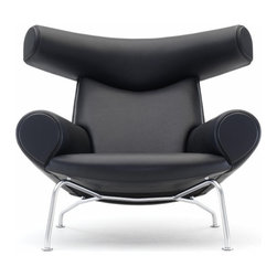 Erik Jorgensen - Wegner Ox Chair - Add a bold dash of style to your space with this Hans J. Wegner–designed armchair. Inspired by the works of Picasso, it's effortlessly chic, sumptuously supportive and eye-catching in all the right ways.