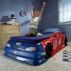 """Step2 - Stock Car Convertible Bed - Have your children racing for bed with this Stock Car Convertible Bed! Modled after a real stock car, this bed features a molded-in race track at the footboard and genuine sponsor decals. Features: -Bed can be configured to accept either a crib or a twin-size mattress (mattresses and bedding not included).-Toddler configuration includes molded-in race track near footboard for die cast vehicle play (cars not included).-High center side rails help child feel more secure.-Ages 2 and up.-Collection: Children's furniture.-Finish: Blue/ Red/ Black.-Hardware Finish: Screws have a trivalent zinc finish.-Distressed: No.-Powder Coated Finish: No.-Gloss Finish: No.-Frame Material: Plastic.-Solid Wood Construction: No.-Hardware Material: Steel.-Non Toxic: Yes.-Scratch Resistant: No.-Box Spring Required: No.-Slats Required: Yes.-Number of Slats Required: 2.-Slat System Included: Yes.-Number of Slats Included: 2.-Center Support Legs: No.-Bed Rails: No.-Also Suitable for Adults: No.-Upholstered: No.-Wingback: No.-Wood Moldings: No.-Canopy Frame: No.-Lighted Headboard: No.-Adjustable Headboard Height: No.-Adjustable Shelves: No.-Underbed Storage: No.-Trundle Bed Included: No.-Hidden Storage: No.-Jewelry Compartment: No.-Attached Nightstand: No.-Media Outlet Hole: No.-Built in Outlets: No.-Weight Capacity: 200 lbs.-Finished Back: No.-Swatch Available: No.-Commercial Use: No.-Eco-Friendly: No.-Product Care: Surfaces easily wipes clean.-Country of Manufacture: United States.Specifications: -FSC Certified: No.-EPP Compliant: No.-CPSIA or CPSC Compliant: Yes.-CARB Compliant: Yes.-JPMA Certified: No.-ASTM Certified: Yes.-ISTA 3A Certified: No.-PEFC Certified: No.-General Conformity Certificate: Yes.-Green Guard Certified : No.Dimensions: -Overall Height - Top to Bottom: 23.63"""".-Overall Width - Side to Side: 49.25"""".-Overall Depth - Front to Back: 89.5"""".-Headboard Height Top to Bottom: 23.63"""".-Headboard Width Side to Side: 49.94"""".-Headboard Depth Front t"""