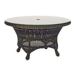 Woodard - Woodard Serengeti Wicker 36 Round Chat Table with Umbrella Hole - One of Woodard�s most unique collections is the Serengeti including the stationary lounge patio chair the Serengeti ottoman and the Serengeti wicker patio swivel rockers among so many other available pieces. The feeling is pure creature comfort and so is the craftsmanship. The Serengeti collection including the patio sofa gliding loveseat stationary lounge patio chair Serengeti ottoman and the popular Serengeti wicker patio swivel rocker is made from All Seasons Wicker that has been hand woven over exceptionally strong aluminum frames. You won�t find better quality and workmanship than with Woodard guaranteed.The easy-maintenance wicker coupled with the wide variety of fabric and chair tie options in colors and designs will keep your deck or patio busy with entertaining your friends family co-workers or just the two of you well past sunset. Enjoy the carefree feeling that the Serengeti collection evokes and put your feet up on the Serengeti ottoman while you sink into the stationary lounge patio chair in well-deserved comfort.The name Woodard Furniture has been synonymous with fine outdoor and patio furniture since the 1930s continuing the company�s furniture craftsmanship dating back over 140 years. Woodard began producing hand-made wrought iron furniture which led the company into cast and tubular aluminum furniture production over the years.� Most recently Woodard patio furniture launched its entry into the all-weather wicker furniture market with All Seasons which is expertly crafted and woven using synthetic wicker supported by an aluminum frame.� The company is widely known for durable beautiful designs that provide attractive and comfortable outdoor living environments.� Its hand-crafted technique used to create the intricate design patterns on its wrought iron furniture have been handed down from generation to generation -- a hallmark of quality unmatched in the furniture industry today. With deep seating slings and metal seating options in a variety of styles Woodard Furniture offers the designs you want with the quality you expect.  Woodard aluminum furniture is distinguished by the purest aluminum used in the manufacturing process resulting in an extremely strong durable product which still can be formed into flowing shapes and forms.� The company prides itself on the fusion of durability and beauty in its aluminum furniture offerings. Finishes on Woodard outdoor furniture items are attuned to traditional and modern design sensibilities. Nineteen standard frame finishes and nineteen premium finishes combined with more than 150 fabric options give consumers countless options to design their own dream outdoor space. Woodard is also the exclusive manufacturer of outdoor furnishings designed by Joe Ruggiero home decor TV personality.� The Ruggiero line includes wrought iron aluminum and all weather wicker designs possessing a modern aesthetic and fashion-forward styling inspired by traditional Woodard patio furniture designs. Rounding out Woodard�s offerings is a line of distinctive umbrellas umbrella bases and outdoor accessories.� These offerings are an integral part of creating a complete outdoor living environment and include outdoor lighting and wall mounted or free standing architectural elements � all made with Woodard�s unstinting attention to detail and all weather durability. Woodard outdoor furniture is an American company headquartered in Coppell Texas with a manufacturing facility in Owosso Michigan.� Its brands are known under the names of Woodard Woodard Landgrave and Woodard Lyon Shaw. With a variety of collections Woodard produces a wide array of collections that will be sure to suit any taste ranging from traditional to contemporary and add comfort and style to any outdoor living space. With designs materials and construction that far surpass the industry standards Woodard Patio Furniture creates beauty and durability that is unparalleled.
