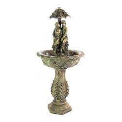 Sunnydaze Decor - Lovers Umbrella Solar On Demand Fountain - A quaint nod to the fountains of yesteryear, this one features a young boy and girl stealing a moment undercover. Your backyard garden or front patio will be even more charming under the spell of its old-fashioned magic. One or two days of sun keeps its solar-powered battery running for up to four hours at a time.