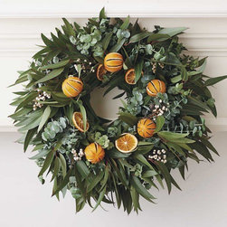 "Viva Terra - Orange Eucalyptus Wreath - Spiral eucalyptus serves as the fragrant base of our custom-made wreath, accented with dried oranges and clusters of tallow berries. Hand-crafted on a family farm in the Salinas Valley, each wreath is individually made, so no two are exactly alike. WREATH 20""DIAM, HANGER 13""L"