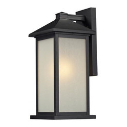 One Light Black White Seedy Glass Wall Lantern - Clean, straight lines and rectangular detailing define the classic styling of this medium outdoor wall mount. White seedy glass panels create an elegant glow, while the cast aluminum hardware finished in black can withstand nature's seasonal elements.